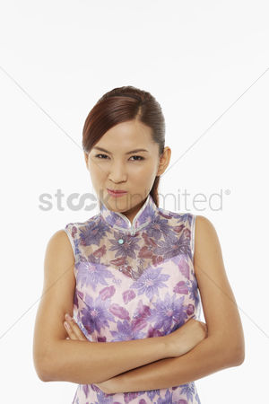 Lunar new year : Woman in traditional clothing looking at the camera with arms crossed