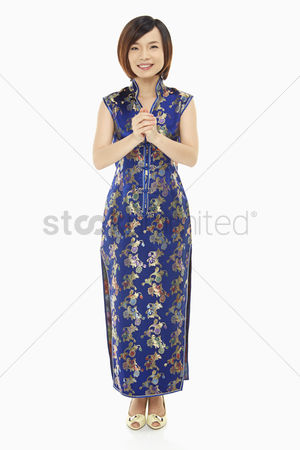 Lunar new year : Woman in traditional clothing showing greeting gesture