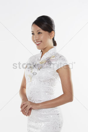Lunar new year : Woman in traditional costume smiling