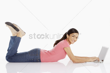 Portability : Woman laying on the floor  using laptop