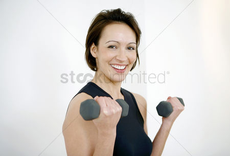 Lady : Woman lifting dumbbells