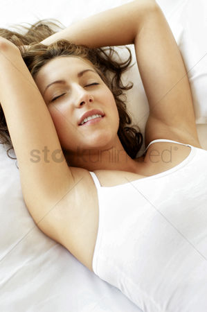 Attraction : Woman lying down on the bed