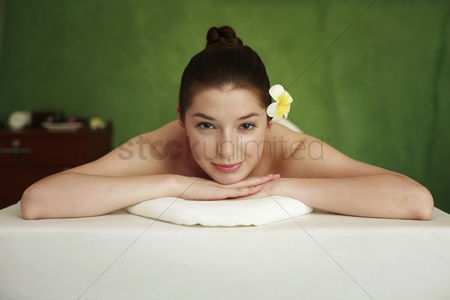 Lying forward : Woman lying forward on the massage table