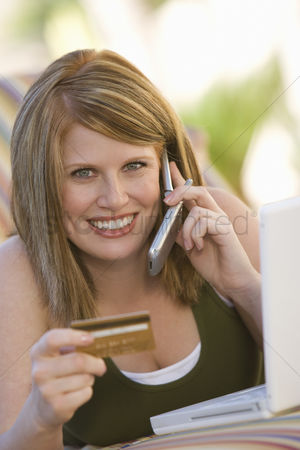 Cellular phone : Woman making credit card purchase