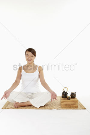 Tea pot : Woman meditating with earphones on