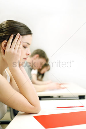 Examination : Woman not paying attention in class