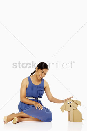Bidayuh ethnicity : Woman petting a paper dog