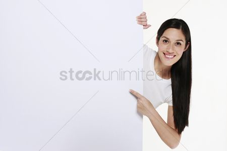 Young woman : Woman pointing at white placard
