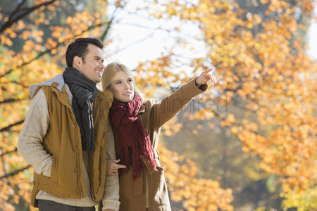 Jacket : Woman pointing while standing with man in park during autumn