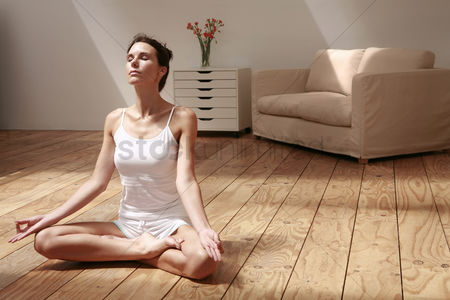Furniture : Woman practising yoga