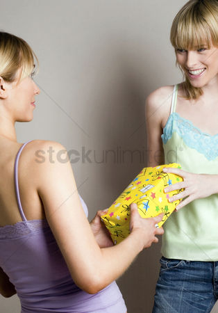 Birthday present : Woman receiving present from her friend