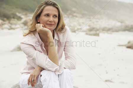 Women : Woman relaxing on beach