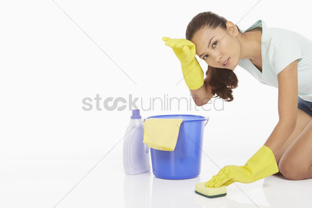 China : Woman scrubbing the floor  feeling exhausted