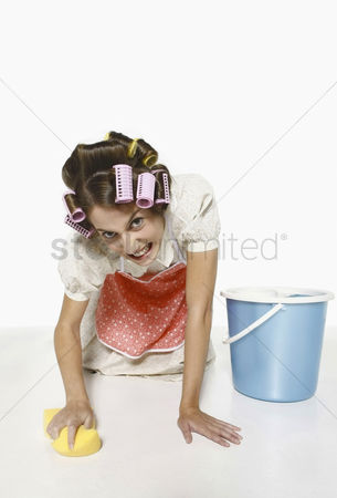 Housewife : Woman scrubbing the floor