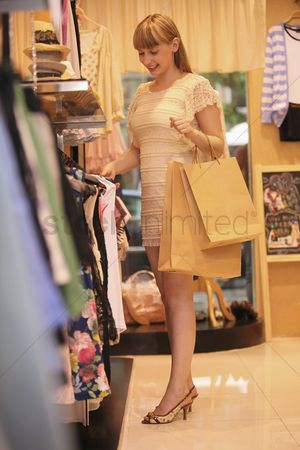 Choosing : Woman shopping in clothes store
