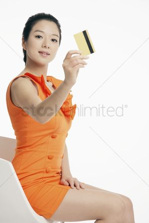 Shopping background : Woman showing credit card
