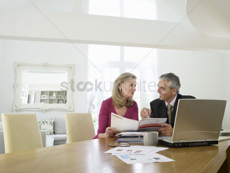 Sitting on lap : Woman sitting at table with financial advisor