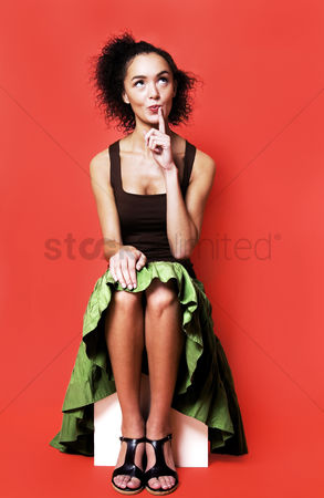 Fashion : Woman sitting down and thinking