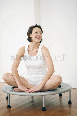 Lively : Woman sitting on a trampoline