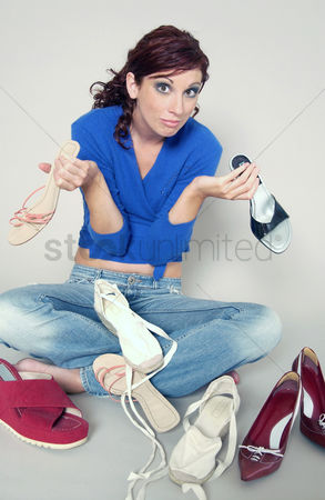 Sets : Woman sitting on the floor selecting shoes to be worn