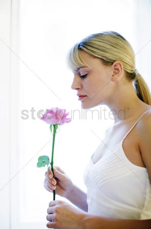 Blossom : Woman smelling flower
