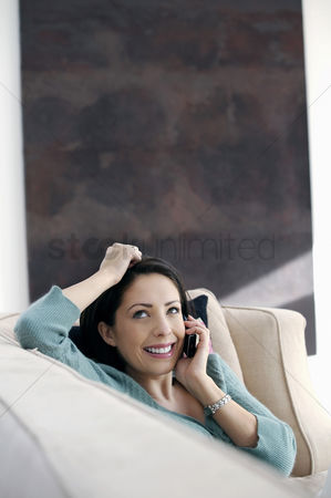 Cellular phone : Woman smiling while talking on the phone