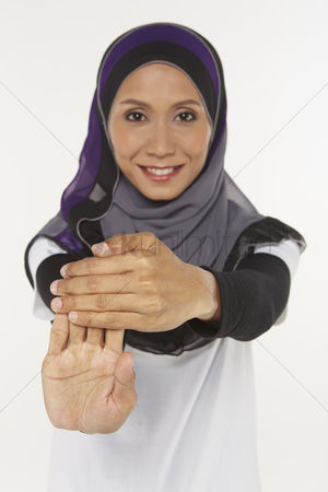 Traditional clothing : Woman stretching fingers upwards