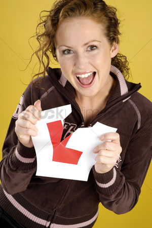 Excited : Woman tearing her l sticker
