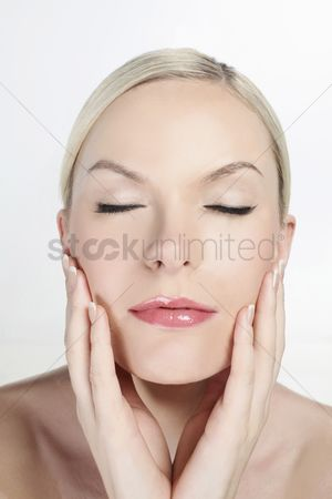 British ethnicity : Woman touching her face