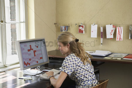 Desk : Woman using computer in office
