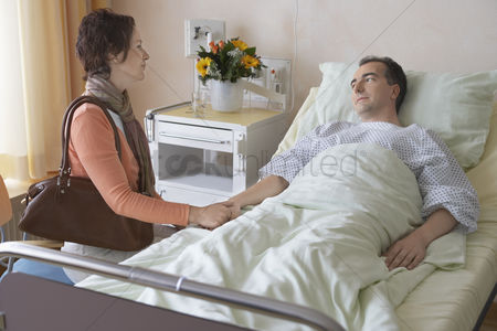 Husband : Woman visiting husband in hospital