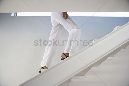 Staircase : Woman walking up staircase indoors low section