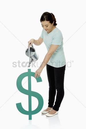 Dollar sign : Woman watering a dollar sign