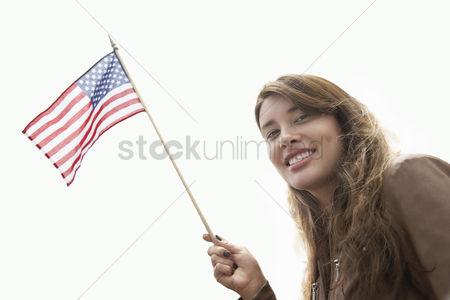 Demonstration : Woman waving american flag head and shoulders