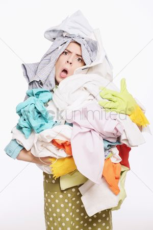 Housewife : Woman with a pile of clothing