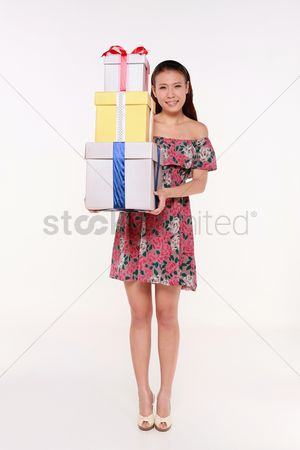 Shopping background : Woman with a stack of gift boxes