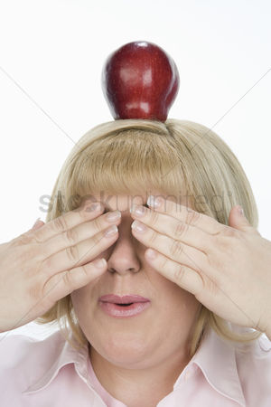 Ignorance : Woman with apple on head