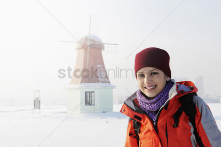 Cold temperature : Woman with backpack walking during winter time