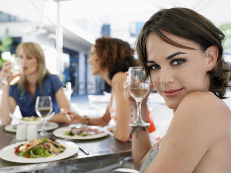 Posing : Woman with friends at outdoor cafe portrait
