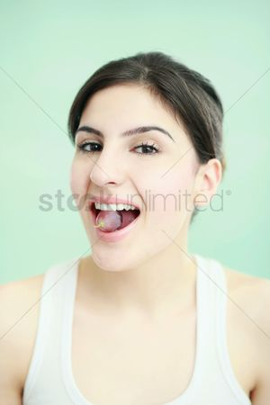 Grapes : Woman with grape in her mouth