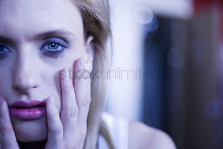 Contemplation : Woman with smudged mascara