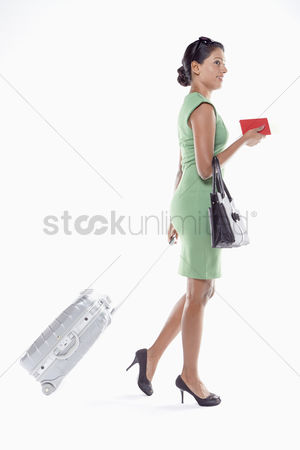 Malaysian indian : Woman with suitcase and passport