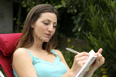 Mature : Woman writing in her diary