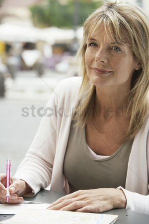 Contemplation : Woman writing postcards
