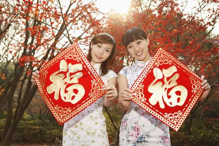 Traditional clothing : Women holding chinese new year decorative item