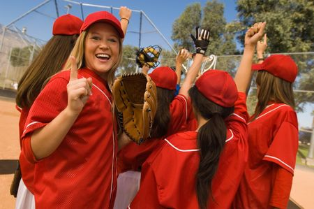 Arm raised : Women s softball team celebrating