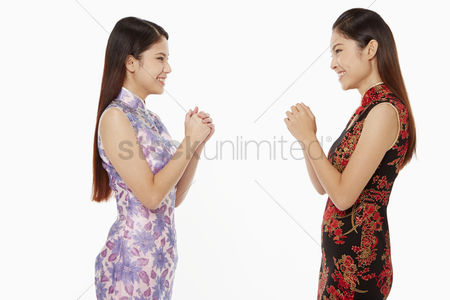 Lunar new year : Women showing greeting gesture