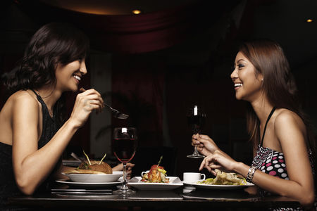 Friends : Women talking while having a meal