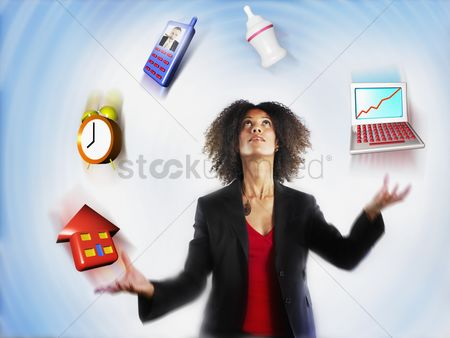 Conceptual : Working mother juggling responsibilities