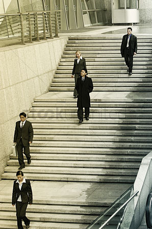 Stairs : Working people in office attire walking down the stairs